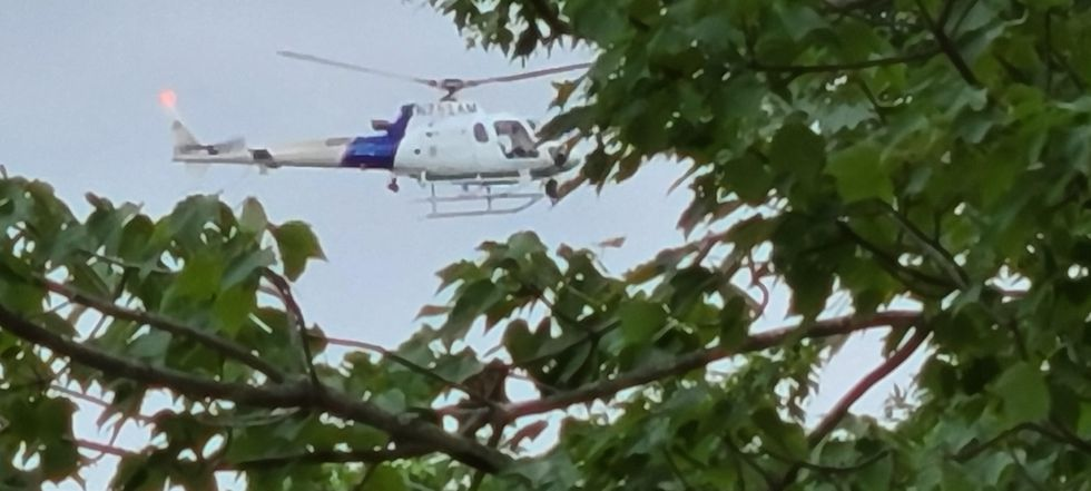 U.S. Customs and Border Protection helicopter searching near lake Iroquois Tuesday