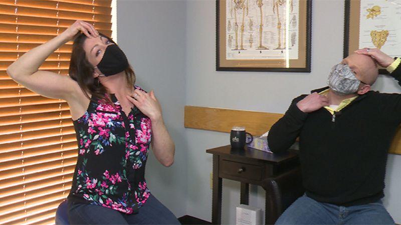 Wendy Hehaffey and Scott work on neck stretch