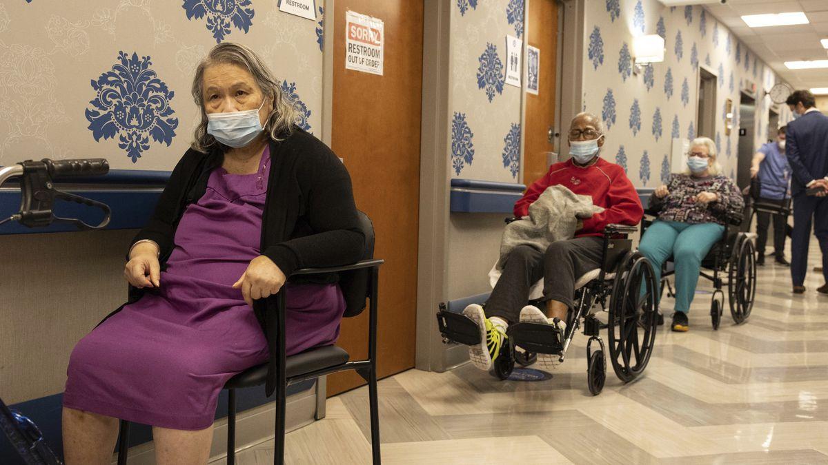 Nursing home residents make a line for the coronavirus disease (COVID-19) vaccine at Harlem...