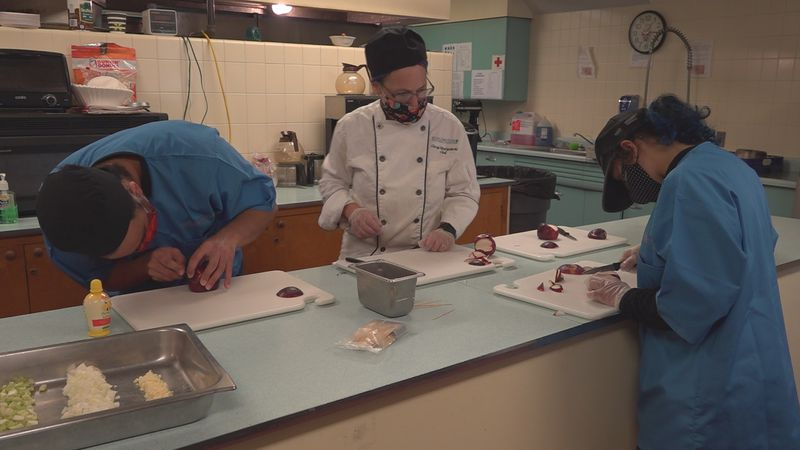 BTC culinary students at work Thursday at Saint Mark's Catholic Church in Burlington.